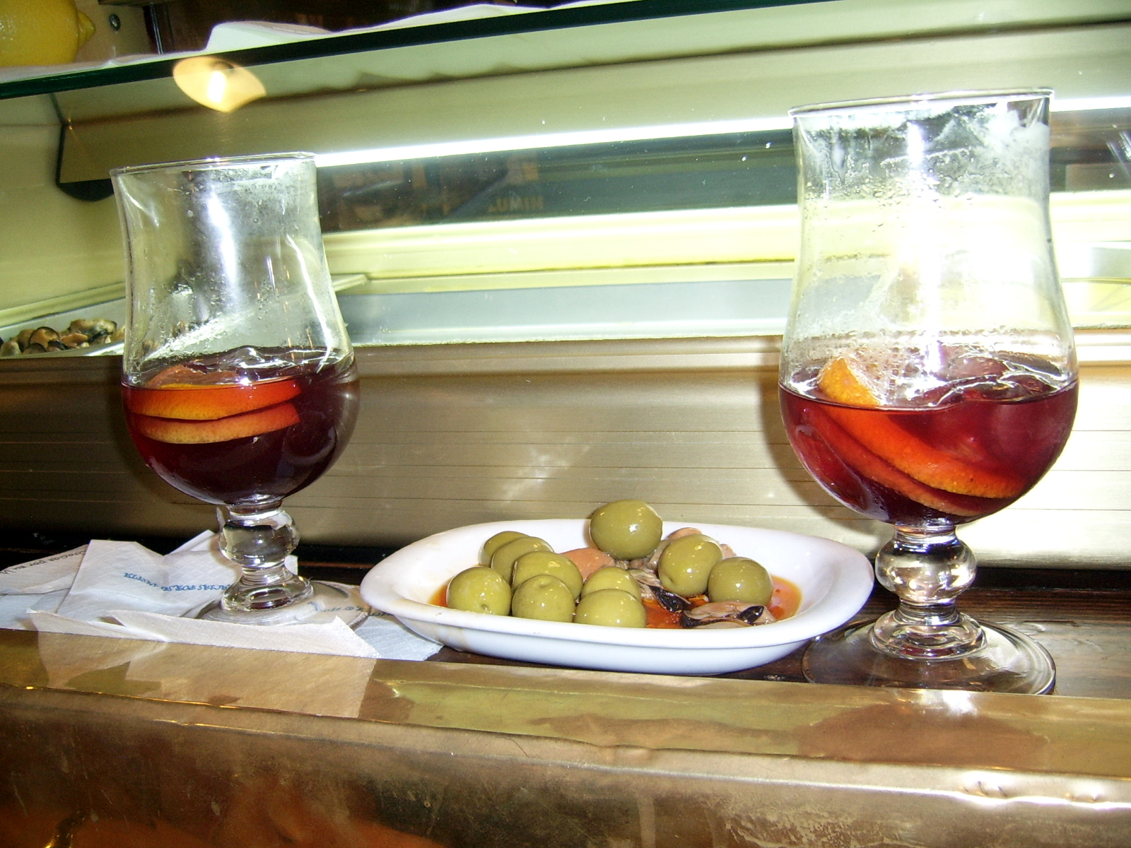 Sangria and basic tapas of olives and marinated muscles at Casa Patas